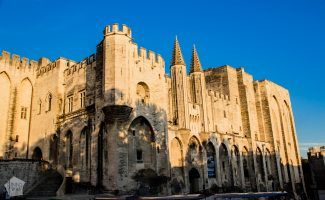 The medieval old town of Avignon is a wonderful travel destination | Gothic-style Palais des Papes | FinnsAway Travel Blog