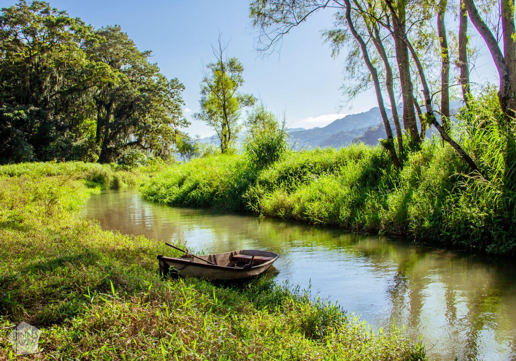 Canal leading to Lago de Yojoa Lake in Honduras | FinnsAway Travel Blog